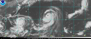 Satellite photo from Noon EDT Thursday of Typhoon Goni (left) and Super Typhoon Atsani 9right)